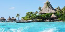 Sofitel Bora-Bora Motu Private Island: hotel dock, beach and bungalows (to the left), and the restaurant/reception building.
